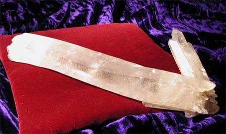 Double terminated lemurian wand with cluster.